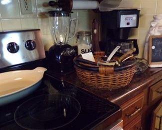 large serving Dish, Basket of misc items, Blender, Bunn Coffee Maker, Pig Statue Chalk message Board