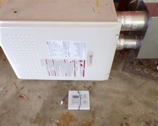 Gas Tankless  Water Heater, used and works -