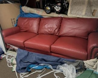 Custom made 8 ft pebble grain leather couch from Leather Creations in rustic barn red with brad detailing. Taking offers.