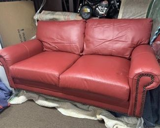 Custom leather 6 ft loveseat from Leather Creations in rustic barn red with brad detailing.  Taking offers.