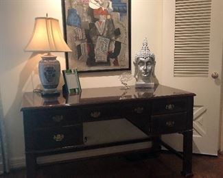 Chippendale style desk and Picaso print that was purchased through Neiman Marcus