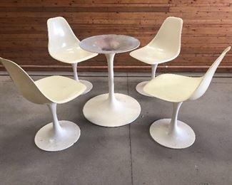 A set of four Vintage Mid century modern fiberglass tulip Saarinen style chairs