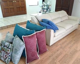 Decorator pillows & cream leather couch, very good condition