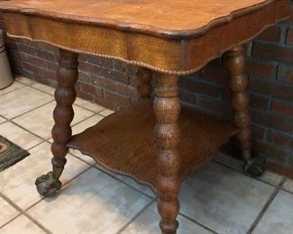 Beautiful Antque parlor table with metal claw feet on glass balls.
