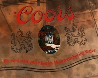 mirrored coors sign