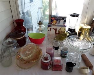 An assortment of vintage glassware Apple peelers, mixers, baking dishes, fabulous candles