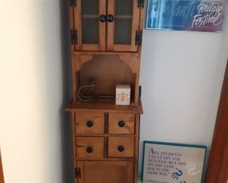 Narrow curio cabinet with drawers