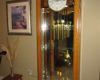"Fabulous  Howard Miller curio oak grandfather clock - I believe is is the ""Eternity"" which retails for $3,300.  Bargain priced at only $995!"