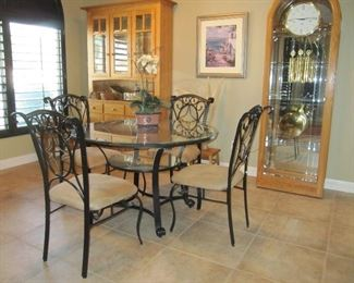 Iron and glass top round dining table with four chairs
