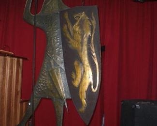 5' Brutalist wall sculpture of a knight in armor with shield in hammered steel and brass