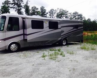 "2003 Mountain Aire Class A 39 Foot Motor Home.  Approx. 70,000 + miles with new engine put in 3 years ago.  The new engine has about 2000 miles on it.  Tires 2 years old. Includes Brake Buddy for 2003 Honda  ""Element"" to be towed.  Honda is included with Motor Home.  Will not be sold separately."