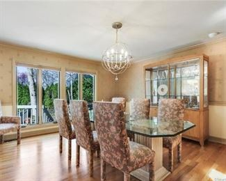 Beveled edge dining table with 8 upholstered chairs. Two arm chairs, 6 side.