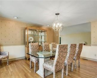 Dining room table, chairs + cabinet