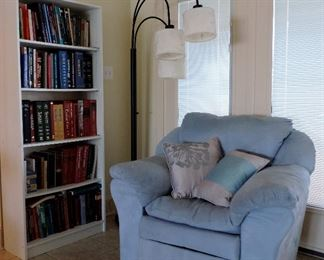 BLUE SUEDE OVER STUFFED ARMCHAIR, FLOORLAMP AND MEDICAL BOOKS