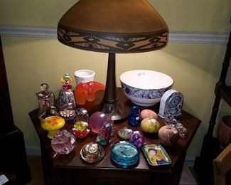 Hexagon stand displaying paperweights, and a Phoenix obverse painted lamp