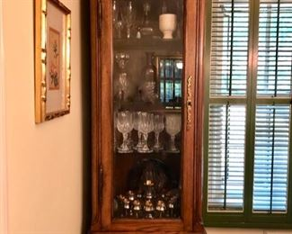 Pair tall curio cabinets