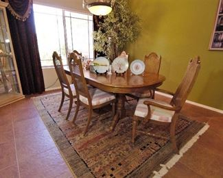 Gorgeous dining room table with leaf. Rug for sale too.