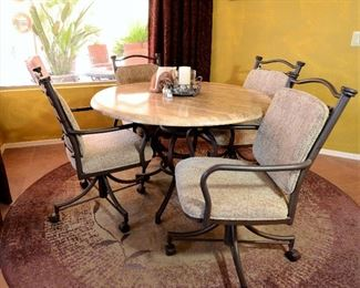 Kitchen or dining table with chairs on rollers. Round rug for sale.