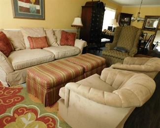 living room ottomans, sofa and mid century swivel club chairs
