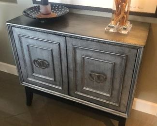 Silvered cabinet is for sale.  Art by G.E. Palmer is for sale. (3 pieces).  Wood and acrylic lamp is not for sale.