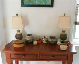 Wooden 2 drawer table/desk, lamps, Native American signed planters, etc.