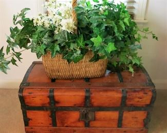 Antique wooden trunk, one of many woven baskets