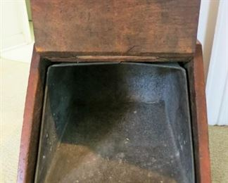 Inside of antique wooden  coal box including galvanized metal inset