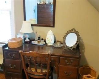 Vintage wooden desk, chair, woven basket, wall mirror, metal dresser mirror, lamps, etc.