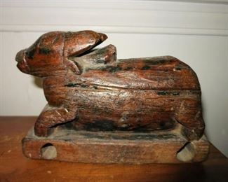 Antique wooden carved animal