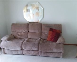 Sofa with opposite end recliners, Mirrored wall decor