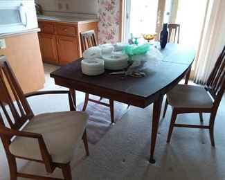 """Mid Century Modern Danish-Style Dining Table with Pads and two leaves; Fire King """"Honeysuckle"""" Large Dinnerware Set"""