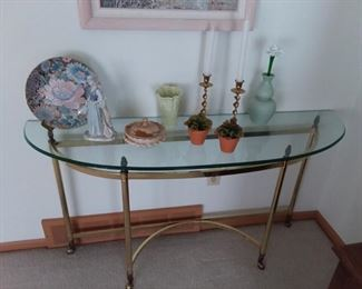 Demi-lune brass and glass topped table; pretty figurines, plates, brass candlesticks and more