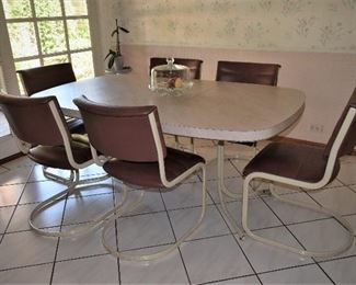 Cantilever Dining chairs, in Milo Baugman style, plus table,