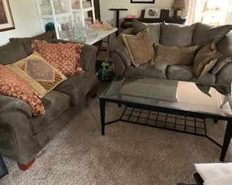 2 sofas, iron/glass coffee table with stone inset