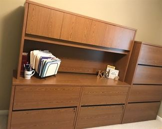 "Two piece L-shaped medium oak desk (Piece against wall is 48""Kx24""Dx29""H and return is 30""Wx68""Lx29H)  Four drawer filing cabinet (36"" W x 20"" D x 59""H)  (Shown to the left of the lateral files) Two Matching lateral files medium oak (36""Wx29""Hx""29H each) Hutch above fiing cabinet smedium oak (44 3/4"" W x 24""Dx29""H Bookcase (36""W x 13"" D x67 3/4"" H_ Chair"