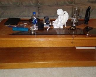Wood coffee table with beveled glass insert