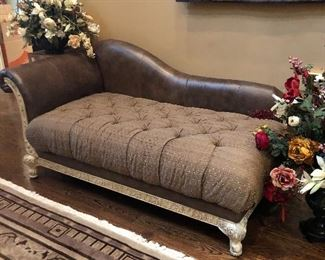 Upholstery & leather chaise lounge with blond wood accents.