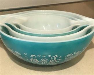 Pyrex bowl set. 2 aqua with white designs, and 2 white with aqua designs.