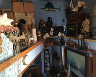 This is just a quick shot of many items available: artwork, figures, small marlin, canon, shells, lighthouses, and much more!