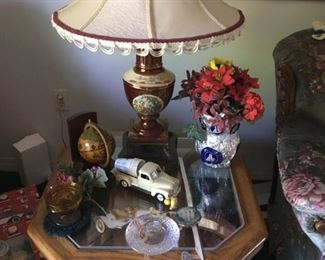 This is a nice ceramic lamp on a glass end table -- notice the toy truck, small glove, candy dish, and more.
