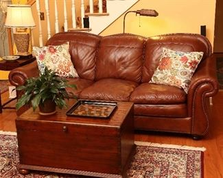 Soflex leather sofa and a fine, dovetailed chest by Hooker Furniture.