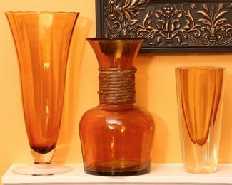 Blown amber glass vases.