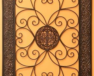 Closer view of large iron work decorative piece.