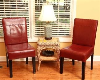 Pair of faux leather chairs with wicker table.