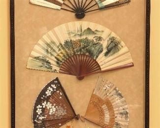 Framed group of old oriental fans.
