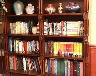 Large, handsome bookcase with fine details and lots of books.
