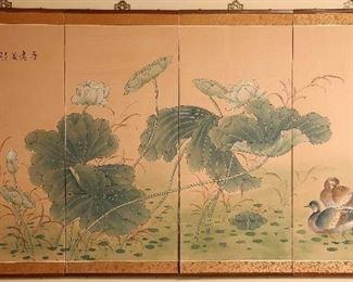 Oriental screen mounted on wall.
