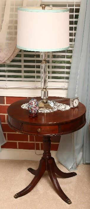Nice bedside table with crystal lamp.
