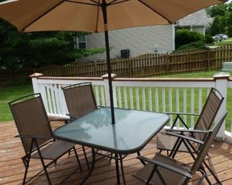 Patio table, chair, and umbrella