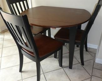 Kitchen table drop leaf and four chairs